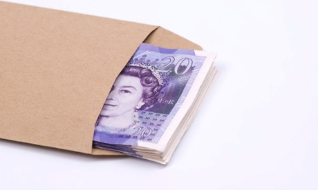 Stack of British money inside a brown envelope against a white background. Image shot 2009. Exact date unknown.